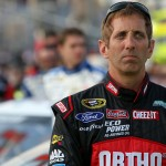 CHARLOTTE, NC - MAY 15: Greg Biffle, driver of the #16 Ortho Ford, stands on the grid prior to during the NASCAR Sprint Cup Series Sprint Showdown at Charlotte Motor Speedway on May 15, 2015 in Charlotte, North Carolina.  (Photo by Brian Lawdermilk/Getty Images)