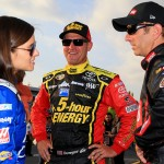 CHARLOTTE, NC - MAY 15:  (L-R) Danica Patrick, driver of the #10 Mobil 1/Aspen Dental Chevrolet, Clint Bowyer, driver of the #15 Cherry 5-Hour Energy/Special Operations Warrior Foundation Toyota, and Greg Biffle, driver of the #16 Ortho Ford, talk on the grid prior to the NASCAR Sprint Cup Series Sprint Showdown at Charlotte Motor Speedway on May 15, 2015 in Charlotte, North Carolina.  (Photo by Daniel Shirey/Getty Images)