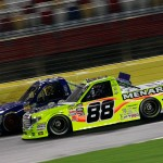 CHARLOTTE, NC - MAY 15:  Matt Crafton, driver of the #88 Great Lakes/Menards Toyota, races Brad Keselowski, driver of the #29 Cooper Standard Careers for Veterans Ford, during the NASCAR Camping World Truck Series North Carolina Education Lottery 200 at Charlotte Motor Speedway on May 15, 2015 in Charlotte, North Carolina.  (Photo by Brian Lawdermilk/Getty Images)