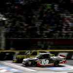 CHARLOTTE, NC - MAY 15: Kasey Kahne, driver of the #00 Haas Automation Chevrolet, takes the checkered flag ahead of Erik Jones, driver of the #4 Dollar General Toyota, to win the NASCAR Camping World Truck Series North Carolina Education Lottery 200 at Charlotte Motor Speedway on May 15, 2015 in Charlotte, North Carolina.  (Photo by Brian Lawdermilk/Getty Images)