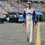 CHARLOTTE, NC - MAY 16:  Jimmie Johnson, driver of the #48 Lowe's Patriotic Chevrolet, walks in the garage area during qualifying for the NASCAR Sprint Cup Series Sprint All-Star Race at Charlotte Motor Speedway on May 16, 2015 in Charlotte, North Carolina.  (Photo by Drew Hallowell/Getty Images)