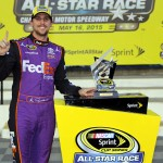 CHARLOTTE, NC - MAY 16:  Denny Hamlin, driver of the #11 FedEx Express Toyota, poses in Victory Lane after qualifying for the pole position in the NASCAR Sprint Cup Series Sprint All-Star Race at Charlotte Motor Speedway on May 16, 2015 in Charlotte, North Carolina.  (Photo by Jerry Markland/Getty Images)