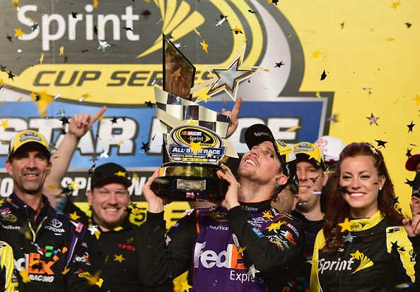 CHARLOTTE, NC - MAY 16:  Denny Hamlin, driver of the #11 FedEx Express Toyota, celebrates in victory lane after winning the NASCAR Sprint Cup Series Sprint All-Star Race at Charlotte Motor Speedway on May 16, 2015 in Charlotte, North Carolina.  (Photo by Jared C. Tilton/Getty Images)