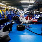 CHARLOTTE, NC - MAY 24: Crew members work on the car of Jimmie Johnson, driver of the #48 Lowe's Patriotic Chevrolet, in the garage after an incident during the NASCAR Sprint Cup Series Coca-Cola 600 at Charlotte Motor Speedway on May 24, 2015 in Charlotte, North Carolina.  (Photo by Jerry Markland/Getty Images)