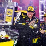 CHARLOTTE, NC - MAY 24:  Carl Edwards, driver of the #19 Subway Toyota, celebrates in Victory Lane after winning the NASCAR Sprint Cup Series Coca-Cola 600 at Charlotte Motor Speedway on May 24, 2015 in Charlotte, North Carolina.  (Photo by Jerry Markland/Getty Images)