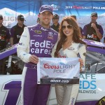 DOVER, DE - MAY 29:  Denny Hamlin, driver of the #11 FedEx Cares Toyota, left, poses with Miss Coors Light Amanda Mertz and the Coors Light Pole Award after qualifying for the pole for the NASCAR Sprint Cup Series FedEx 400 Benefiting Autism Speaks at Dover International Speedway on May 29, 2015 in Dover, Delaware.  (Photo by Nick Laham/Getty Images)