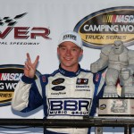 DOVER, DE - MAY 29:  Tyler Reddick, driver of the #19 BBR Music Group Ford, poses with the Miles the Monster trophy in Victory Lane after winning the NASCAR Camping World Truck Series Lucas Oil 200 at Dover International Speedway on May 29, 2015 in Dover, Delaware.  (Photo by Sean Gardner/Getty Images)