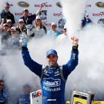 DOVER, DE - MAY 31:  Jimmie Johnson, driver of the #48 Lowe's Pro Services Chevrolet, celebrates in Victory Lane after winning the NASCAR Sprint Cup Series FedEx 400 Benefiting Autism Speaks at Dover International Speedway on May 31, 2015 in Dover, Delaware.  (Photo by Todd Warshaw/Getty Images)