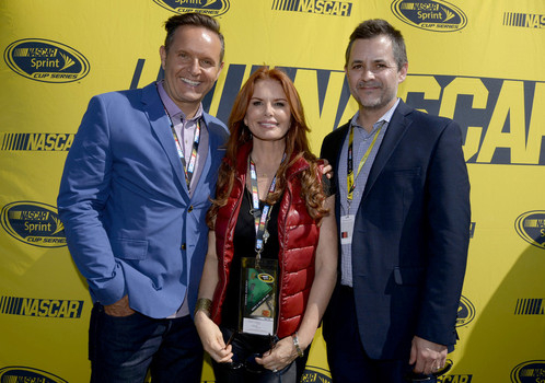 (L-R) Producer Mark Burnett, actress Roma Downey and Zane Stoddard pose for photos before the NASCAR Sprint Cup Series Toyota/Save Mart 350 at Sonoma Raceway on June 28, 2015 in Sonoma, California (Photo by Robert Laberge/Getty Images)