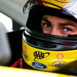 "LONG POND, PA - JUNE 05:  Joey Logano, driver of the #22 Shell Pennzoil Ford, sits in his car during qualifying for the NASCAR Sprint Cup Series Axalta ""We Paint Winners"" 400 at Pocono Raceway on June 5, 2015 in Long Pond, Pennsylvania.  (Photo by Brian Lawdermilk/Getty Images)"