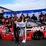 "LONG POND, PA - JUNE 05:  Kurt Busch, driver of the #41 Haas Automation Chevrolet, left, poses with Miss Coors Light Amanda Mertz and the Coors Light Pole Award after qualifying for the pole for the NASCAR Sprint Cup Series Axalta ""We Paint Winners"" 400 at Pocono Raceway on June 5, 2015 in Long Pond, Pennsylvania.  (Photo by Chris Trotman/Getty Images)"