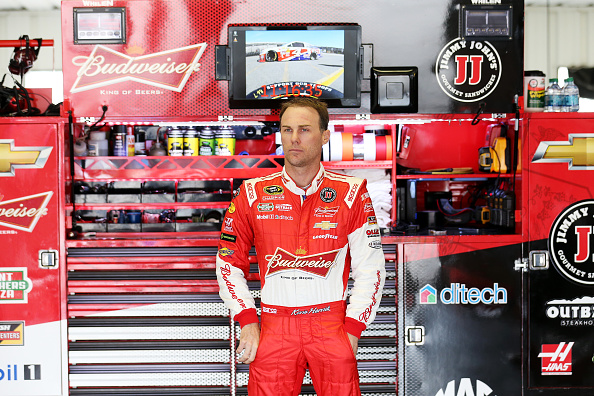 LONG POND, PA - JUNE 06:  Kevin Harvick, driver of the #4 Budweiser/Jimmy John's Chevrolet, looks on in the garage area during practice for the NASCAR Sprint Cup Series Axalta 'We Paint Winners' 400 at Pocono Raceway on June 6, 2015 in Long Pond, Pennsylvania.  (Photo by Nick Laham/Getty Images)