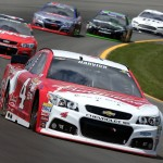 LONG POND, PA - JUNE 07:  Kevin Harvick, driver of the #4 Budweiser/Jimmy John's Chevrolet, leads a pack of cars during the NASCAR Sprint Cup Series Axalta 'We Paint Winners' 400 at Pocono Raceway on June 7, 2015 in Long Pond, Pennsylvania.  (Photo by Nick Laham/Getty Images)