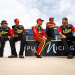 BROOKLYN, MI - JUNE 12:  Clint Bowyer (center), driver of the #15 Cherry 5-hour ENERGY benefiting Special Operations Warrior Foundation Toyota, sits on the wall with his crew members during qualifying for the NASCAR Sprint Cup Series Quicken Loans 400 at Michigan International Speedway on June 12, 2015 in Brooklyn, Michigan.  (Photo by Brian Lawdermilk/Getty Images)