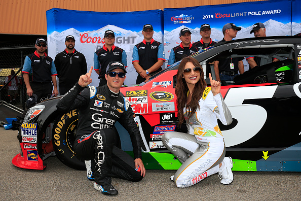 BROOKLYN, MI - JUNE 12:  Kasey Kahne, driver of the #5 Great Clips Chevrolet, poses with Miss Coors Light Amanda Mertz after winning the pole during qualifying for the NASCAR Sprint Cup Series Quicken Loans 400 at Michigan International Speedway on June 12, 2015 in Brooklyn, Michigan.  (Photo by Chris Trotman/Getty Images)