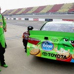BROOKLYN, MI - JUNE 12:  Kyle Busch, driver of the #18 M&M's Crispy Toyota, stands on the grid during qualifying for the NASCAR Sprint Cup Series Quicken Loans 400 at Michigan International Speedway on June 12, 2015 in Brooklyn, Michigan.  (Photo by Jerry Markland/Getty Images)