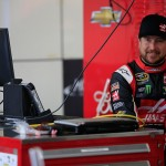 BROOKLYN, MI - JUNE 13:  Kurt Busch, driver of the #41 Haas Automation Chevrolet, stands in the garage area during practice for the NASCAR Sprint Cup Series Quicken Loans 400 at Michigan International Speedway on June 13, 2015 in Brooklyn, Michigan.  (Photo by Chris Trotman/Getty Images)