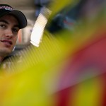 BROOKLYN, MI - JUNE 13:  Joey Logano, driver of the #22 Shell-Pennzoil Ford, stands in the garage area during practice for the NASCAR Sprint Cup Series Quicken Loans 400 at Michigan International Speedway on June 13, 2015 in Brooklyn, Michigan.  (Photo by Chris Trotman/Getty Images)