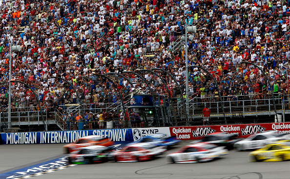 BROOKLYN, MI - JUNE 14:  Cars race during the NASCAR Sprint Cup Series Quicken Loans 400 at Michigan International Speedway on June 14, 2015 in Brooklyn, Michigan.  (Photo by Jerry Markland/Getty Images)