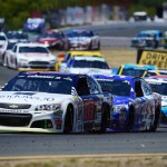 SONOMA, CA - JUNE 28:  Dale Earnhardt Jr., driver of the #88 Microsoft Chevrolet, leads a pack of cars during the NASCAR Sprint Cup Series Toyota/Save Mart 350 at Sonoma Raceway on June 28, 2015 in Sonoma, California.  (Photo by Jared C. Tilton/Getty Images)