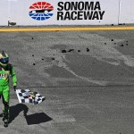 SONOMA, CA - JUNE 28:  Kyle Busch, driver of the #18 M&M's Crispy Toyota, celebrates after winning the NASCAR Sprint Cup Series Toyota/Save Mart 350 at Sonoma Raceway on June 28, 2015 in Sonoma, California.  (Photo by Jonathan Moore/Getty Images)