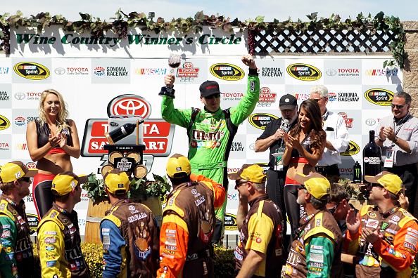 SONOMA, CA - JUNE 28:  Kyle Busch, driver of the #18 M&M's Crispy Toyota, celebrates in Victory Lane after winning during the NASCAR Sprint Cup Series Toyota/Save Mart 350 at Sonoma Raceway on June 28, 2015 in Sonoma, California.  (Photo by Tim Bradbury/Getty Images)