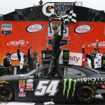 BROOKLYN, MI - JUNE 13:  Kyle Busch, driver of the #54 Monster Energy Toyota, celebrates in victory lane after winning the NASCAR XFINITY Series Great Clips 250 Benefiting Paralyzed Veterans of America at Michigan International Speedway on June 13, 2015 in Brooklyn, Michigan.  (Photo by Jonathan Ferrey/NASCAR via Getty Images) *** Local Caption *** Kyle Busch