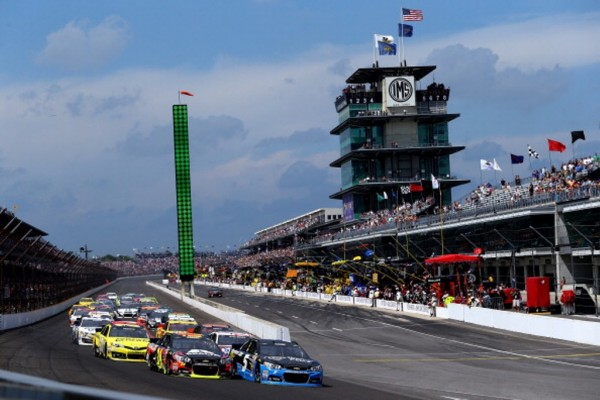 INDIANAPOLIS, IN - JULY 27 2014:  Jeff Gordon, driver of the #24 Axalta Chevrolet, and Kasey Kahne, driver of the #5 Time Warner Cable Chevrolet, lead the field to the final restart in the NASCAR Sprint Cup Series Crown Royal Presents The John Wayne Walding 400 at the Brickyard Indianapolis Motor Speedway on July 27, 2014 in Indianapolis, Indiana.  (Photo by Andy Lyons/Getty Images)