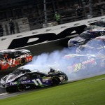 DAYTONA BEACH, FL - JULY 06:  Denny Hamlin, driver of the #11 FedEx Ground Toyota, spins causing a wreck during the NASCAR Sprint Cup Series Coke Zero 400 Powered by Coca-Cola at Daytona International Speedway on July 6, 2015 in Daytona Beach, Florida.  (Photo by Chris Graythen/Getty Images)