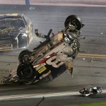 DAYTONA BEACH, FL - JULY 06:  Austin Dillon, driver of the #3 Bass Pro Shops Chevrolet, is involved in an on-track incident following the checkered flag during the NASCAR Sprint Cup Series Coke Zero 400 Powered by Coca-Cola at Daytona International Speedway on July 6, 2015 in Daytona Beach, Florida.  (Photo by Patrick Smith/Getty Images)
