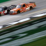 SPARTA, KY - JULY 09:  Erik Jones, driver of #4 Special Olympics World Games Toyota, and Daniel Suarez, driver of the #51 ARRIS Toyota, race during the NASCAR Camping World Truck Series UNOH 225 at Kentucky Speedway on July 9, 2015 in Sparta, Kentucky.  (Photo by Sarah Crabill/Getty Images)