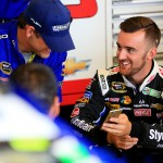 SPARTA, KY - JULY 10:  Austin Dillon, driver of the #3 DOW Styrofoam Chevrolet, right, talks with crew members in the garage area during practice for the NASCAR Sprint Cup Series Quaker State 400 Presented by Advance Auto Parts at Kentucky Speedway on July 10, 2015 in Sparta, Kentucky.  (Photo by Daniel Shirey/Getty Images)