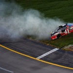 SPARTA, KY - JULY 11:  Kurt Busch, driver of the #41 Haas Automation Chevrolet, spins through the infield grass during the NASCAR Sprint Cup Series Quaker State 400 presented by Advance Auto Parts at Kentucky Speedway on July 11, 2015 in Sparta, Kentucky.  (Photo by Jonathan Moore/Getty Images)