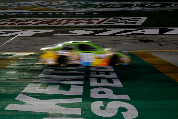 SPARTA, KY - JULY 11:  Kyle Busch, driver of the #18 M&M's Crispy Toyota, races during the NASCAR Sprint Cup Series Quaker State 400 presented by Advance Auto Parts at Kentucky Speedway on July 11, 2015 in Sparta, Kentucky.  (Photo by Todd Warshaw/Getty Images)