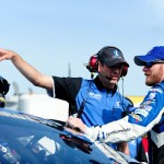 LOUDON, NH - JULY 17:  Dale Earnhardt Jr., driver of the #88 Nationwide Chevrolet, talks with his crew chief Greg Ives on pit road during qualifying for the NASCAR Sprint Cup Series 5-Hour Energy 301 at New Hampshire Motor Speedway on July 17, 2015 in Loudon, New Hampshire.  (Photo by Jeff Curry/Getty Images)