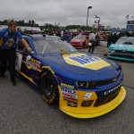 LOUDON, NH - JULY 18:  Crew members push the #9 NAPA Auto Parts Chevrolet, driven by Chase Elliott, down pit road prior to qualifying for the NASCAR XFINITY Series Lakes Region 200 at New Hampshire Motor Speedway on July 18, 2015 in Loudon, New Hampshire.  (Photo by Rainier Ehrhardt/Getty Images)