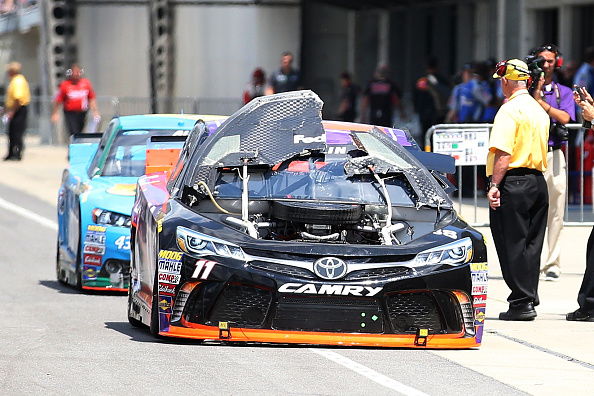 Denny Hamlin enters the garage with a damaged hood during practice for the NASCAR Sprint Cup Series Crown Royal Presents the Jeff Kyle 400 at the Brickyard at Indianapolis Motorspeedway on July 24, 2015 in Indianapolis, Indiana.