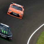 INDIANAPOLIS, IN - JULY 25:  Kyle Busch, driver of the #54 Monster Energy Toyota, leads Daniel Suarez, driver of the #18 ARRIS Toyota, during the NASCAR XFINITY Series Lilly Diabetes 250 at Indianapolis Motor Speedway on July 25, 2015 in Indianapolis, Indiana.  (Photo by Robert Laberge/Getty Images)