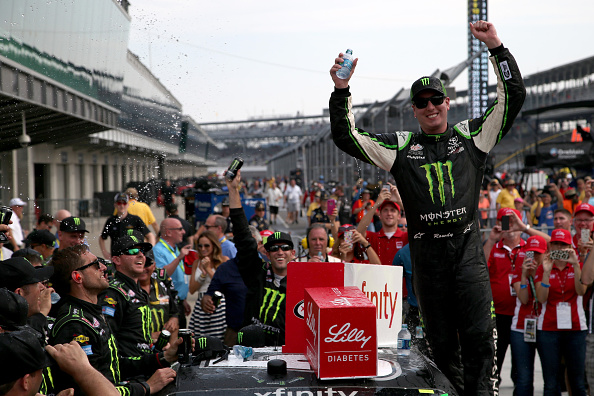 Kyle Busch celebrates after the NASCAR XFINITY Series Lilly Diabetes 250 at Indianapolis Motor Speedway on July 25, 2015 in Indianapolis, Indiana.