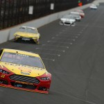 INDIANAPOLIS, IN - JULY 26:  Joey Logano, driver of the #22 Shell Pennzoil Ford, leads a pack of cars during the NASCAR Sprint Cup Series Crown Royal Presents the Jeff Kyle 400 at the Brickyard at Indianapolis Motor Speedway on July 26, 2015 in Indianapolis, Indiana.  (Photo by Andy Lyons/Getty Images)