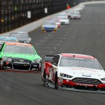 INDIANAPOLIS, IN - JULY 26:  Greg Biffle, driver of the #16 Lilly/American Diabetes Association Ford, leads a pack of cars during the NASCAR Sprint Cup Series Crown Royal Presents the Jeff Kyle 400 at the Brickyard at Indianapolis Motor Speedway on July 26, 2015 in Indianapolis, Indiana.  (Photo by Andy Lyons/Getty Images)
