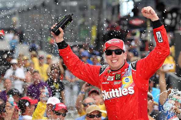 Kyle Busch celebrates after winning the NASCAR Sprint Cup Series Crown Royal Presents the Jeff Kyle 400 at the Brickyard at Indianapolis Motor Speedway on July 26, 2015 in Indianapolis, Indiana.