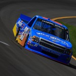 LONG POND, PA - JULY 31:  Spencer Gallagher, driver of the #23 Allegiant Travel Chevrolet, practices for the NASCAR Camping World Truck Series Pocono Mountains 150 at Pocono Raceway on July 31, 2015 in Long Pond, Pennsylvania.  (Photo by Chris Trotman/Getty Images)