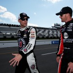LONG POND, PA - JULY 31:  Kevin Harvick, driver of the #4 Jimmy John's/Budweiser Chevrolet, left, and Jeb Burton, driver of the #26 Maxim Toyota, walk on the grid prior to qualifying for the NASCAR Sprint Cup Series Windows 10 400 at Pocono Raceway on July 31, 2015 in Long Pond, Pennsylvania.  (Photo by Nick Laham/Getty Images)