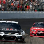 Kevin Harvick, driver of the #4 Jimmy John's/Budweiser Chevrolet, leads Kurt Busch, driver of the #41 Haas Automation Chevrolet, during the NASCAR Sprint Cup Series 5-Hour ENERGY 301 at New Hampshire Motor Speedway on July 19, 2015 in Loudon, New Hampshire.