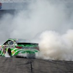 Kyle Busch, driver of the #18 Interstate Batteries Toyota, celebrates with a burnout after winning the NASCAR Sprint Cup Series 5-Hour ENERGY 301 at New Hampshire Motor Speedway on July 19, 2015 in Loudon, New Hampshire.