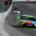 LONG POND, PA - AUGUST 02:  Kyle Busch, driver of the #18 M&M's Crispy Toyota, leads a pack of cars during the NASCAR Sprint Cup Series Windows 10 400 at Pocono Raceway on August 2, 2015 in Long Pond, Pennsylvania.  (Photo by Jared C. Tilton/Getty Images)