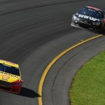 LONG POND, PA - AUGUST 02: Joey Logano, driver of the #22 Shell Pennzoil Ford, leads Martin Truex Jr., driver of the #78 Furniture Row/Visser Precision Chevrolet, during the NASCAR Sprint Cup Series Windows 10 400 at Pocono Raceway on August 2, 2015 in Long Pond, Pennsylvania.  (Photo by Jared C. Tilton/Getty Images)