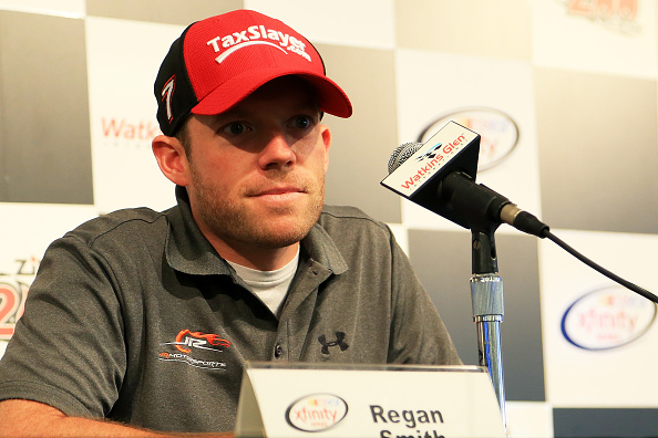 WATKINS GLEN, NY - AUGUST 07:  Regan Smith, driver of the #7 TaxSlayer.com Chevrolet, speaks to the media during a press conference prior to practice for the NASCAR XFINITY Series Zippo 200 at Watkins Glen International on August 7, 2015 in Watkins Glen, New York.  (Photo by Daniel Shirey/Getty Images)