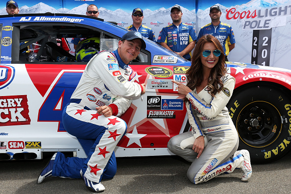 WATKINS GLEN, NY - AUGUST 08:  AJ Allmendinger, driver of the #47 Kroger/Bush's Beans Chevrolet, poses with Miss Coors Light Amanda Mertz and the Coors Light Pole Award decal after qualifying for the pole position for the NASCAR Sprint Cup Series Cheez-It 355 at Watkins Glen International on August 8, 2015 in Watkins Glen, New York.  (Photo by Todd Warshaw/Getty Images)